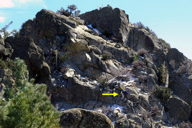 This shot shows Tom making his way to the peak (arrow) and John with his arms in the air standing on the actual summit.