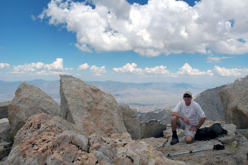 Me on the summit of Thor Peak at 12,300 feet with a view to the east.