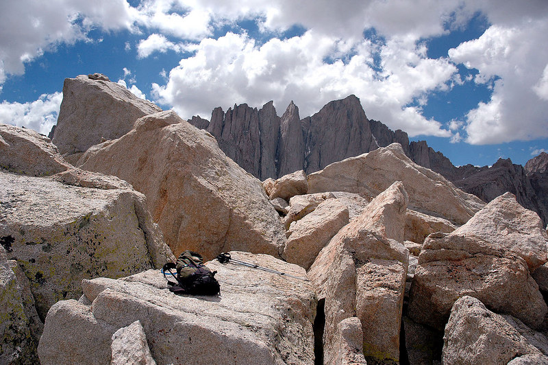 My stuff on the summit of Thor Peak with Mt Whitney in the background. The summit register is in the pile of small rocks at the upper left, which is the actual summit.