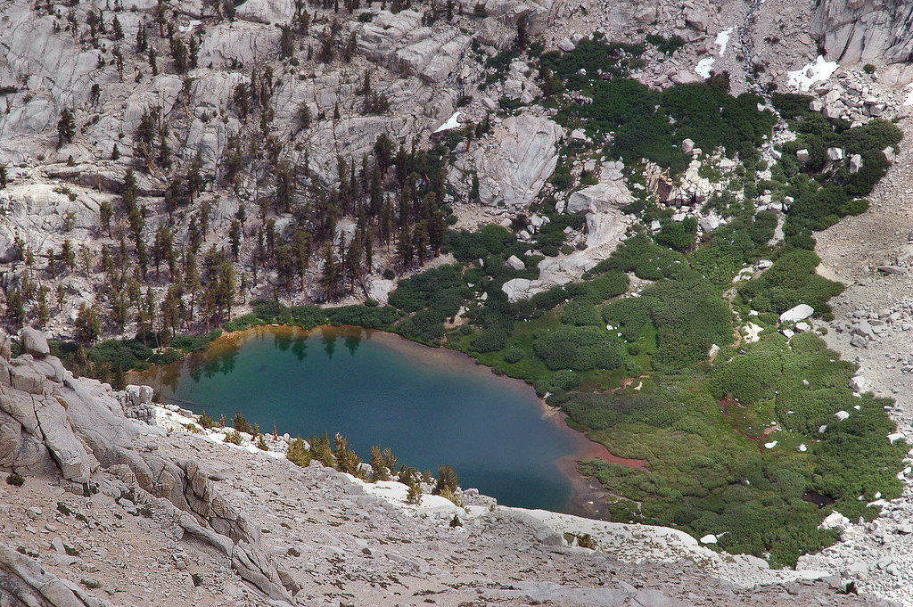 Looking down on Mirror Lake 1,600 feet below, this side of Thor is steep.