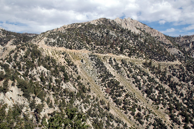 As we hiked on, Wonoga Peak came into view. Also the hang gliders can be seen setting up on the left end of the road.