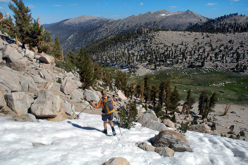 Hiking on the small patch of snow just below the saddle.
