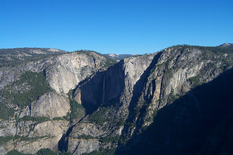 Since we had to launch early, there wasn't any lift. So we only get about 15 minutes in the air.  Knowing that I would only have a short time in the air, I planed to fly strait to Yosemite Falls. That's it ahead. That tiny white spot just to the right of the falls is another glider.