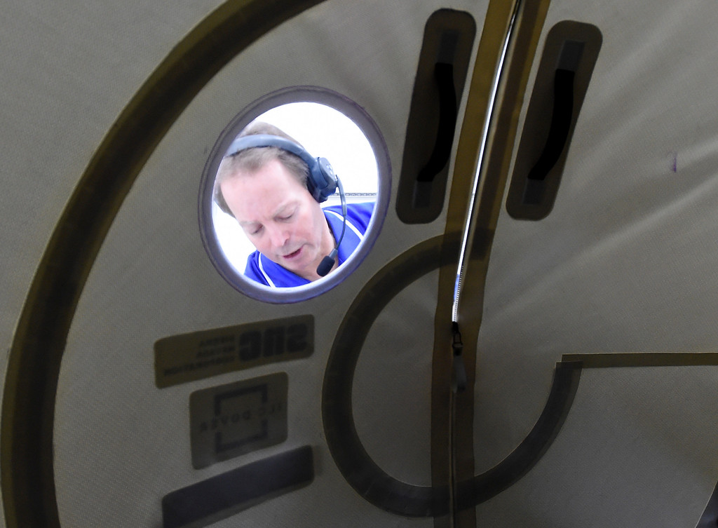 . LOUISVILLE, CO - April2, 2019:  Grant McFarland zips up the airtight door. Sierra Nevada Corporation (SNC) gave a tour of its inflated space habitat, a prototype for NASA�s moon-orbiting Gateway concept. The habitat is one portion of SNC�s complete Gateway Architecture, and includes sleeping space, stairs, an Astro Garden® system and exercise equipment.  (Photo by Cliff Grassmick/Staff Photographer)