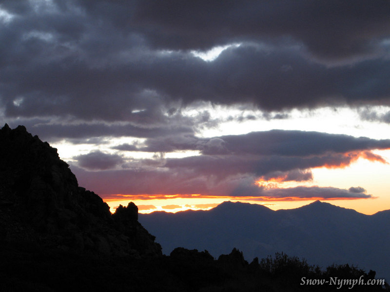 Sunrise and clouds over the Inyos, Inyo an Keynot Peaks on the horizon
