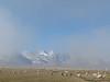 Peak and sheep thru clouds