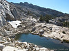 Snow and pond on other side of Tuolumne Pass saddle