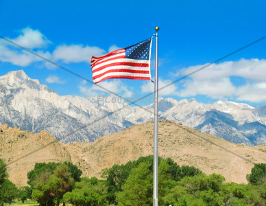 This photo is of Mt. Whitney from the Ranger Station in Lone Pine.  When the wind is just right, old glory stands out nicely and makes for a beautiful picture!