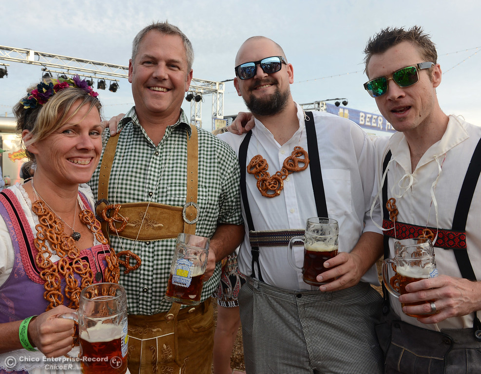 . With pretzel necklaces, Lorrie Hunter, Skip Hunter, Corey Cochrane and Fredeike Brock smile for picture as Sierra Nevada Brewing Co. holds its first of four Oktoberfest celebrations Friday, Sept. 29, 2017, in Chico, California. (Dan Reidel -- Enterprise-Record)