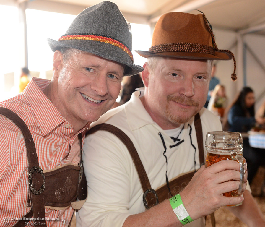 . In lederhosen and tryolean hats, Chuck Cox and Wayne Bickell enjoy a beer with their meal as Sierra Nevada Brewing Co. holds its first of four Oktoberfest celebrations Friday, Sept. 29, 2017, in Chico, California. (Dan Reidel -- Enterprise-Record)