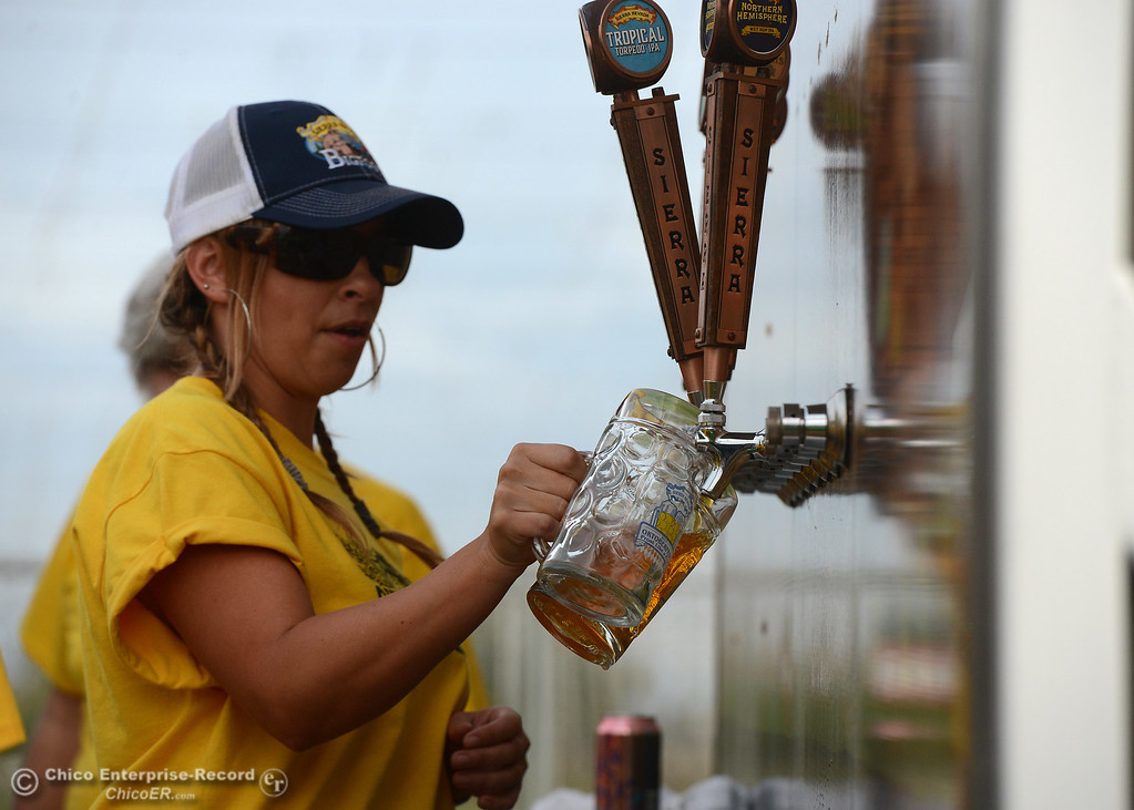 . Erica Martin fills steins as Sierra Nevada Brewing Co. holds its first of four Oktoberfest celebrations Friday, Sept. 29, 2017, in Chico, California. (Dan Reidel -- Enterprise-Record)