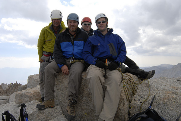 The team taking time out for a quick summit photo before descending ahead of the oncoming storm