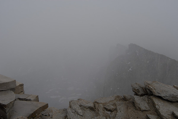 As clouds surrounded Keeler Needle immediately south of Mt. Whitney it began to hail.  The summit is no place to be in a storm so it was time to descend.
