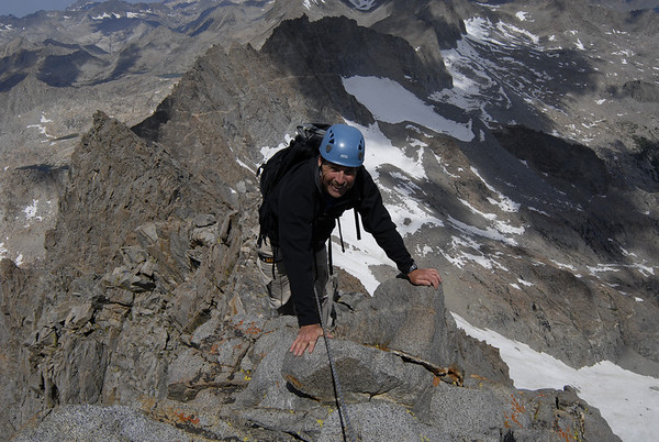 Greg on the summit ridge of Norman Clyde Peak