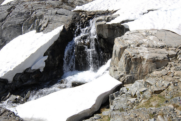 The snow melted off late this year after the Sierra experienced an unusually stormy June.  We encountered several snow patches that were still recently revealing creeks and waterfalls.  Beautiful!