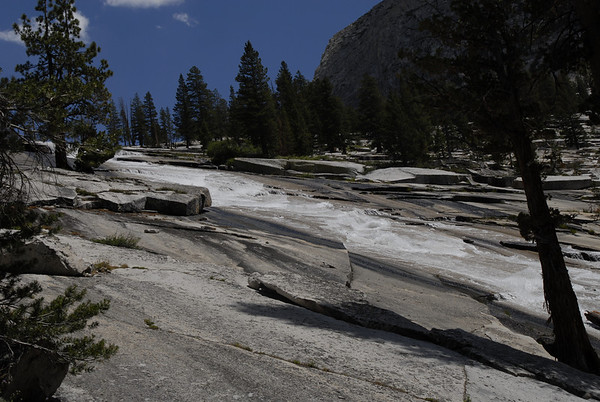 River coming from Dusy Basin flowing over granite slabs.