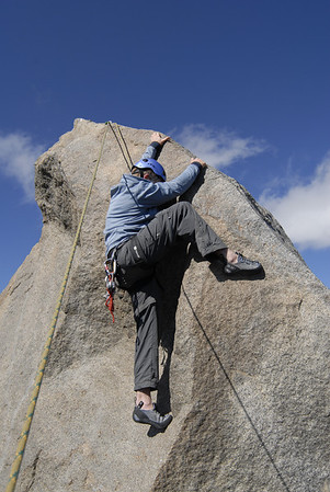 Ben climbing the final summit block on Thunderbolt Peak