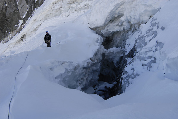 Crossing the bergshrund where the Palisade Glacier separates from the cliff above creating this crevasse.