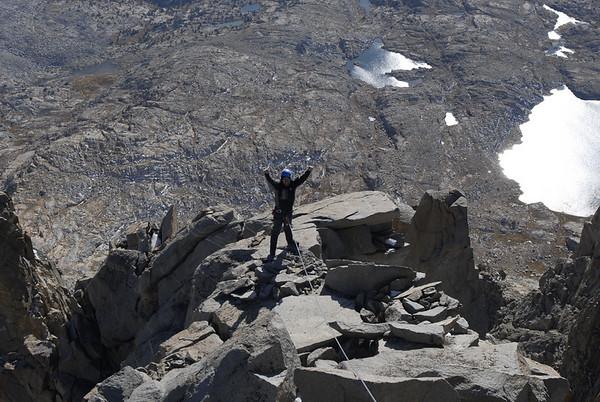 Ben near the summit of Polemonium Peak with Barrett Lake and the Palisade Basin far below.