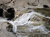 Graceful water sliding over slick granite