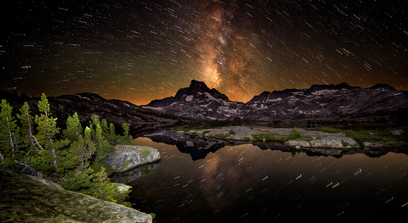Star trails over Thousand Island Lake and Banner Peak. I lightpainted the landscape around me and shot multiple exposures of the sky to get this effect— one to get the trails and the other to get the stopping point.