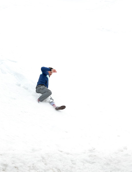 Jared sliding down a snowbank for fun.