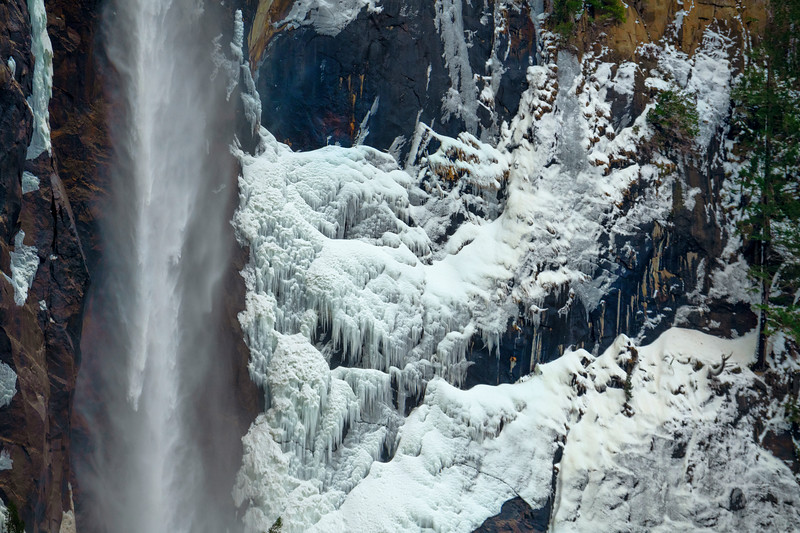 Beautiful shapes of ice develop along the shaded north wall of Bridalveil Falls.