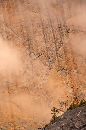 The west slope of Half Dome during a misty sunrise.