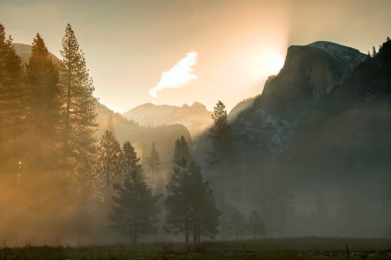 A misty sunrise viewed from the valley floor of Yosemite.