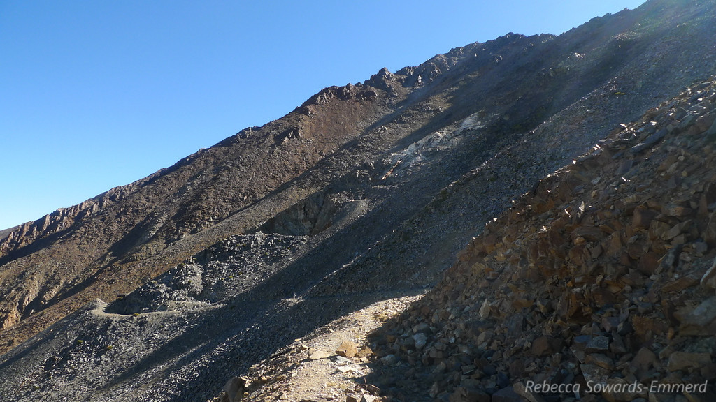 We come around a curve and see the ruins and diggings from the Tungstar Mine. Also, some steep chutes.