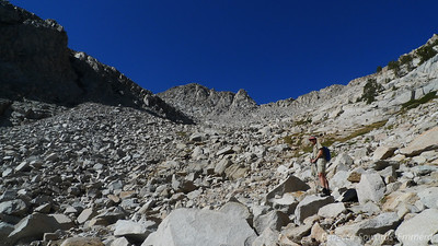 Working our way around to the second lake. A bit of rock hopping through here but nothing too hard.  There was some slabby bedrock through here.