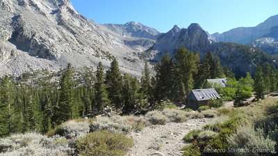 Old mining cabins above Horton Lake. And a peek at tomorrow's route up Basin Mountain (summit still not visible from here, but the route goes up the valley straight ahead)