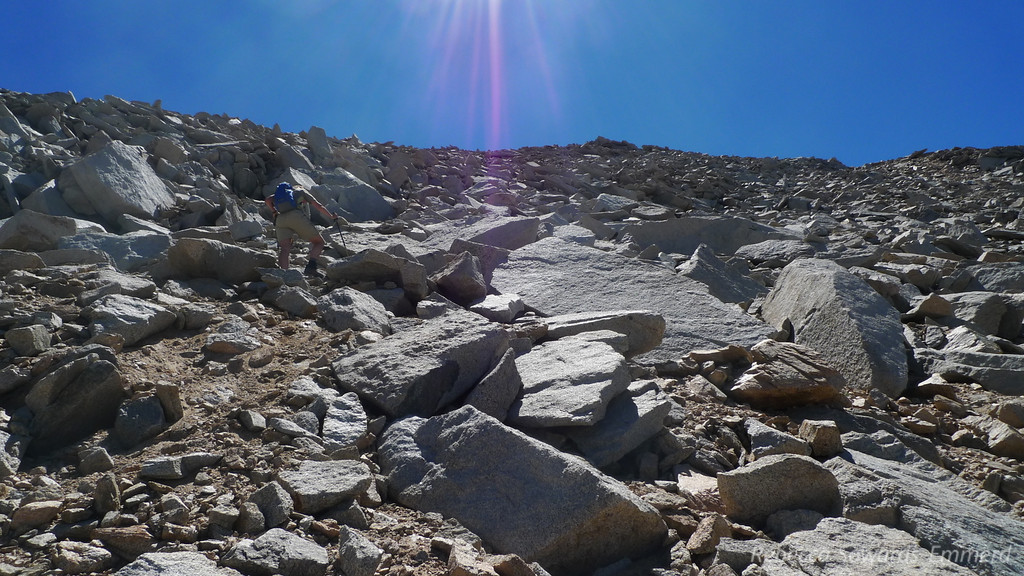 The summit is finally close and the rocks are getting a bit bigger. We ditch our poles for the final few hundred feet.