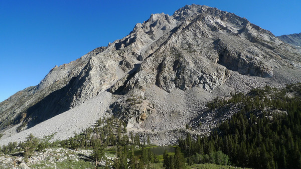 A view of the northern end of Basin mountain from the trail, with lower Horton Lake below. The summit is not visible from here, it's well-hidden behind these lower points.