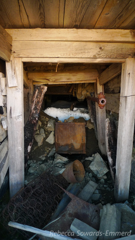Inside one of the tunnels. The ore cart is now just holding snow.