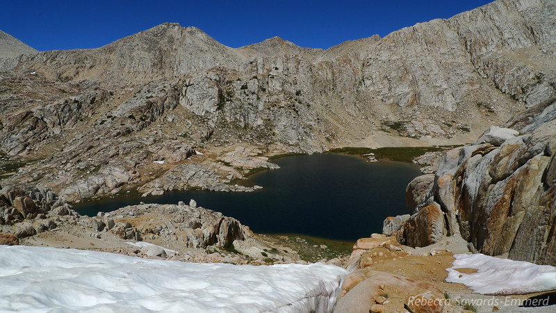 Bear Paw Lake. We got walled out at this awkward snow field so we backtracked and went down a different chute from the pass.
