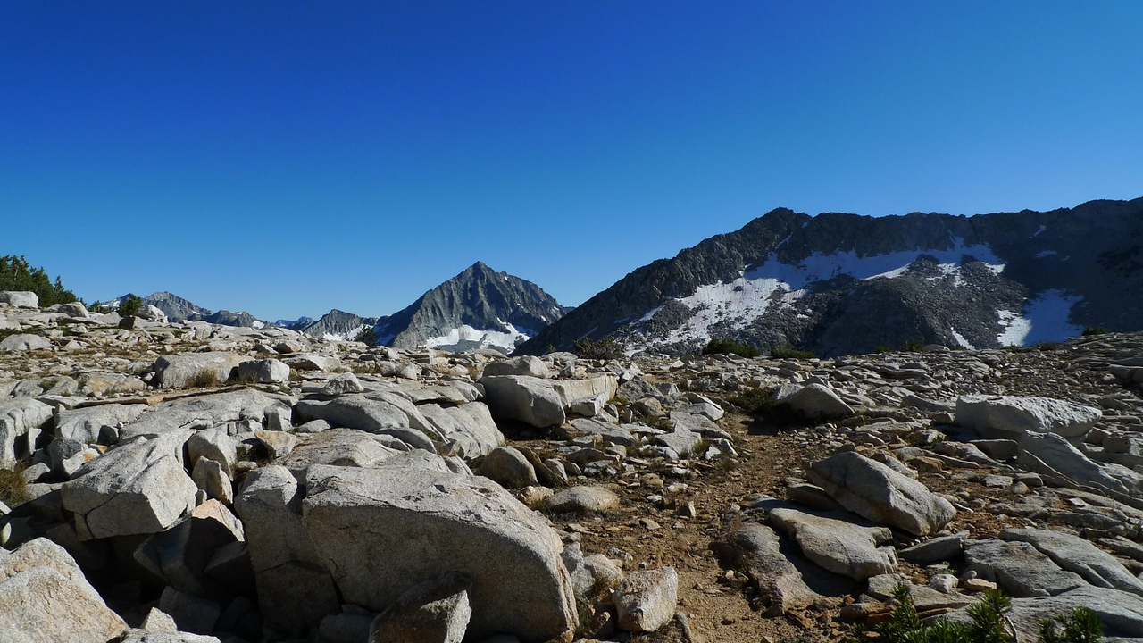 Up at the Pass, Arrow Peak still dominates the view to the south.