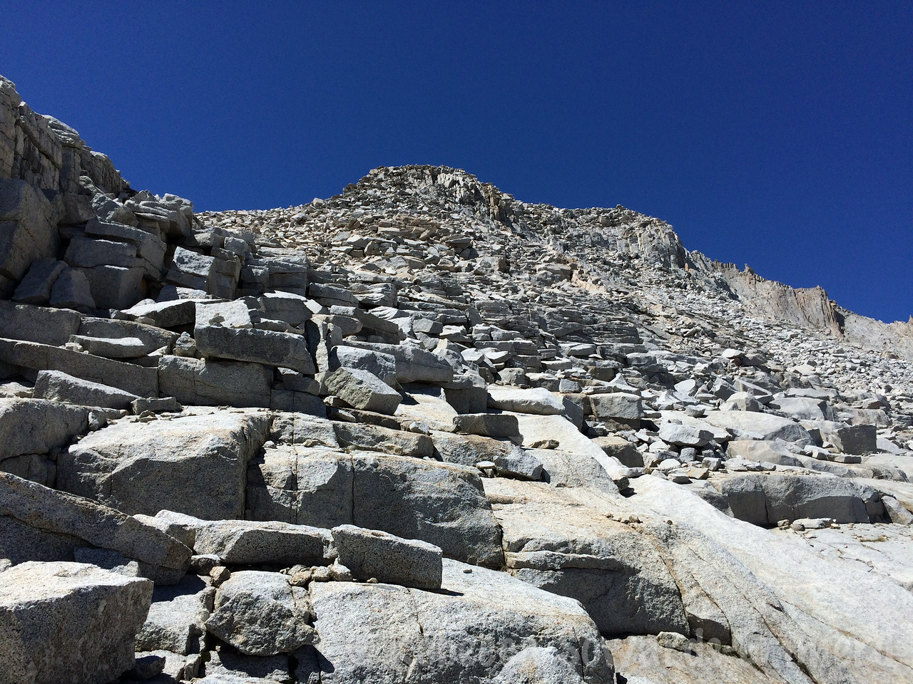 We're finally on the rib and off the slabs - time for some boulder scrambling.