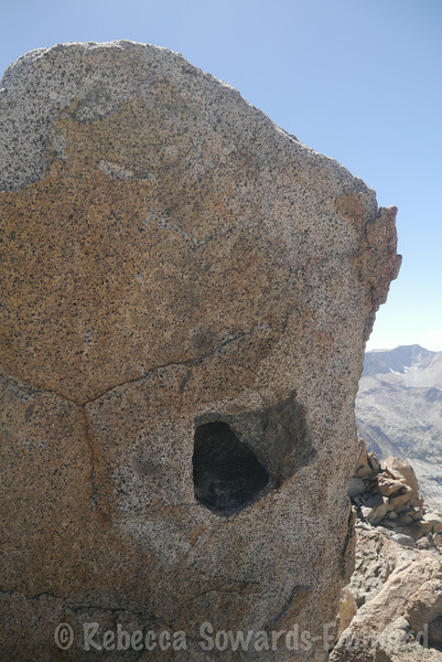 The summit rock with its little register cozy.