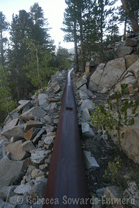 The old pipe works as a perfectly graded trail before it meets the established trail a few switchbacks below Bluff Lake
