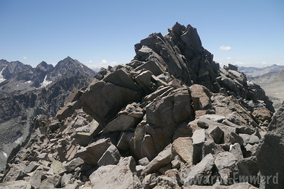At this point, it looks like some big class 3 moves, but it can largely be avoided by dropping slightly to the left and around to the base of the summit rocks.