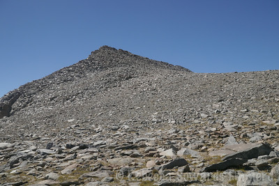 Getting closer to Vagabond. The easiest point to cross over the peak is at the notch just right of the summit.
