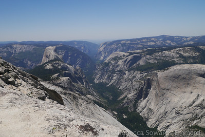 On the ridge, one finally catches a view of Half dome and Yosemite Valley