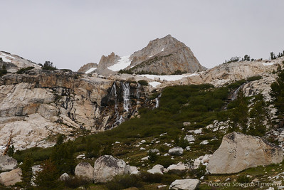 The use trail wanders through the granite slabs to the right of the waterfalls.