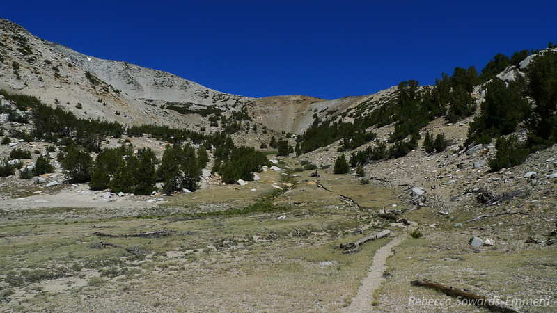 The trail heads up to a plateau at about 11,700 ft.