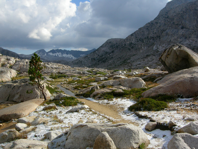 Wet and slushy trail. Here we started running into a lot of JMT hikers that had hunkered down for the storm and were now miserably trudging up towards the pass.