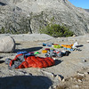 "We awoke on Day 4 to our first perfectly clear morning. It felt like the cold front had finally come through (yesterday's storms), and i had a hunch that we were done with the rain for the rest of the trip. Here is all of my gear finishing the dry-out on my ""organizing rock""."