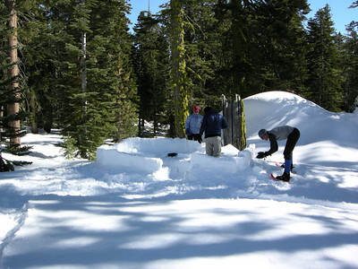 In camp, Dave and Greg work on the snow kitchen.