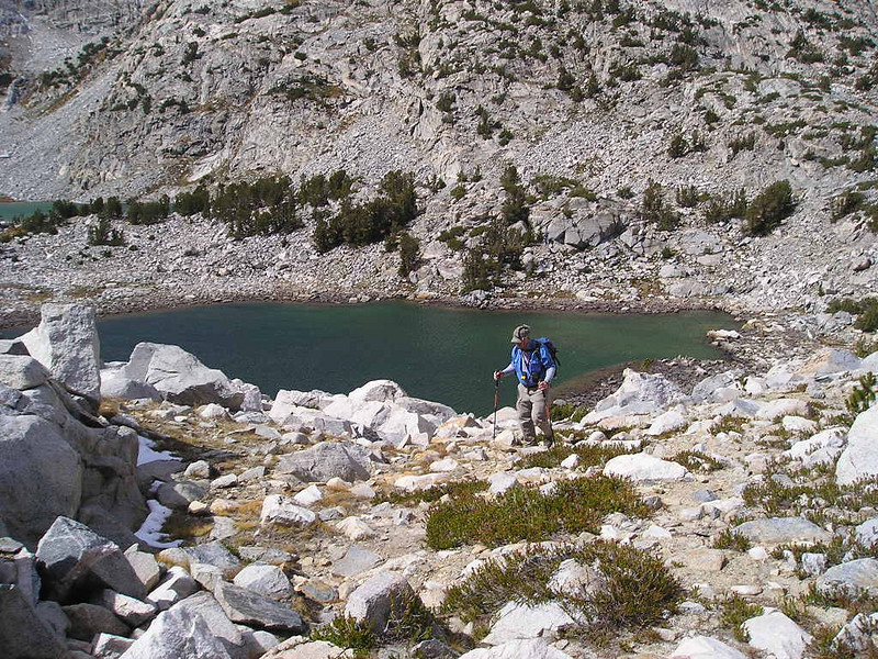 Frank climbing out of the Treasure Lakes basin.<br /> <br /> We cut over a small pass to get to Gem Lake and rejoin the trail