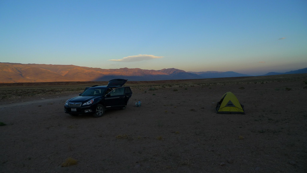 Camp on the Volcanic Tablelands. Love the shadow cast by the sierra on the whites from sunset.